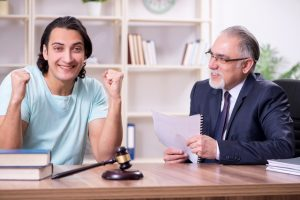 The young man visiting experienced male lawyer